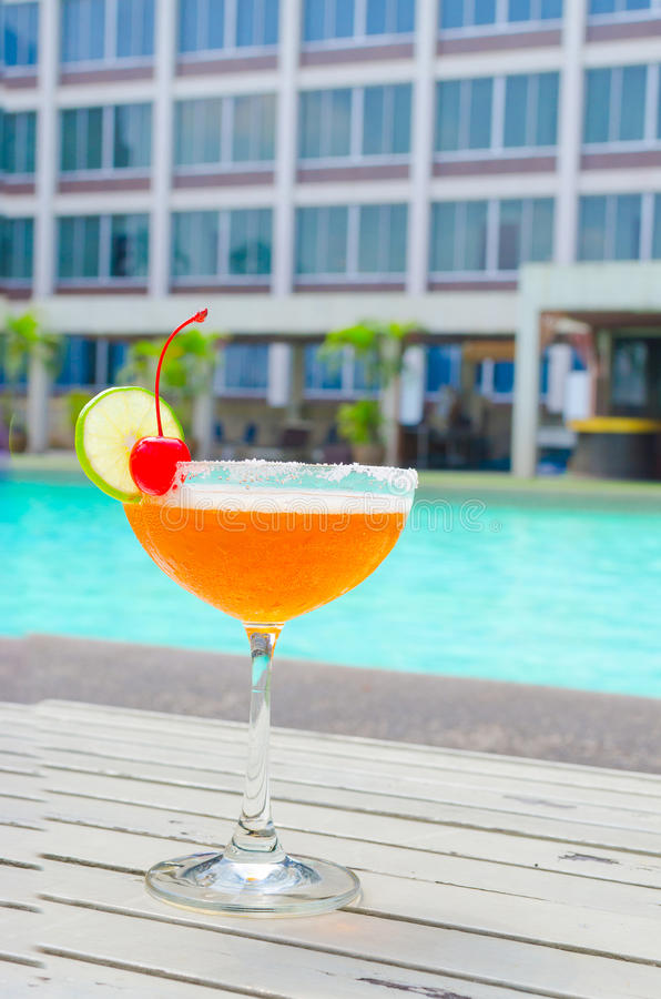 Cocktails near the swimming pool on summer stock photo
