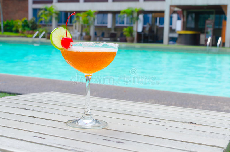 Cocktails near the swimming pool on summer stock photography