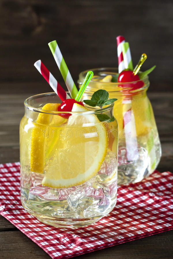 Cocktails. Refreshing cocktails in mason jars over wooden background stock images