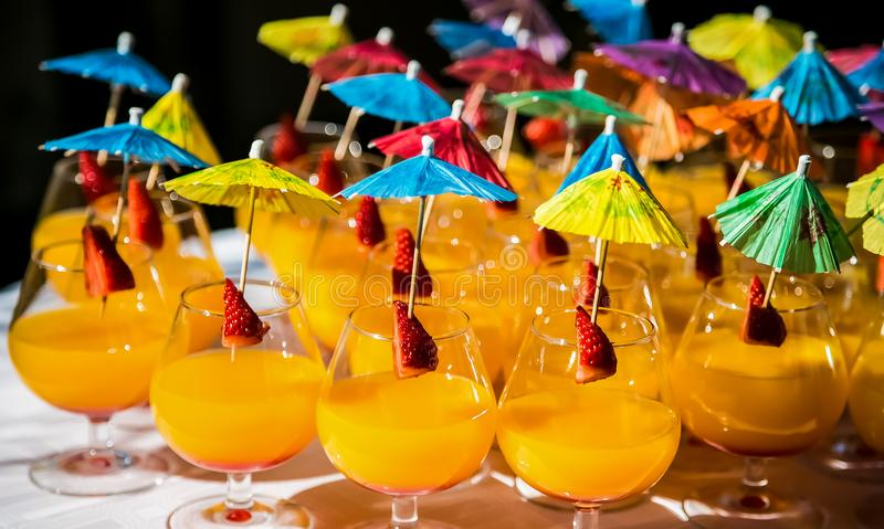 Cocktails with umbrellas at a spring festival corporate event stock image