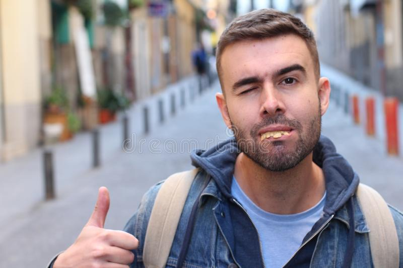 Cocky ugly man with rotten teeth giving a thumbs up.  stock image