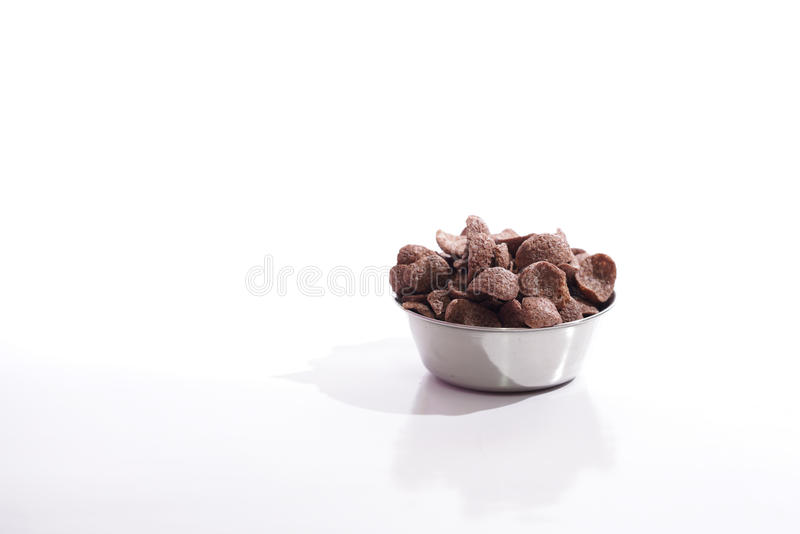 Coco serial in a steel bowl over white background stock photography