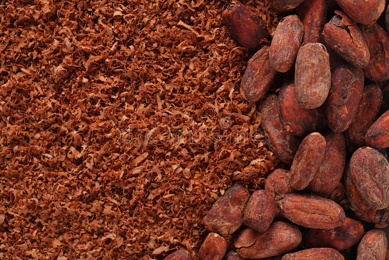 Download Cocoa Beans And Grated Chocolate Background Stock Photo - Image of macro, bean: 33441642