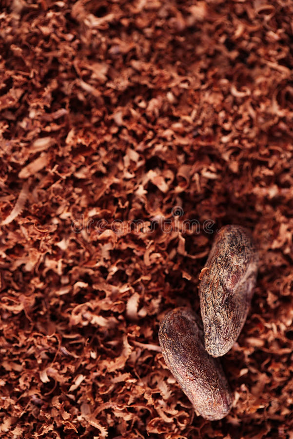 Cocoa Beans And Grated Chocolate Background Royalty Free Stock Photos