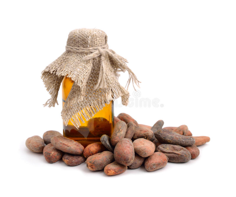 Cocoa beans before roast with pharmaceutical bottle. stock images