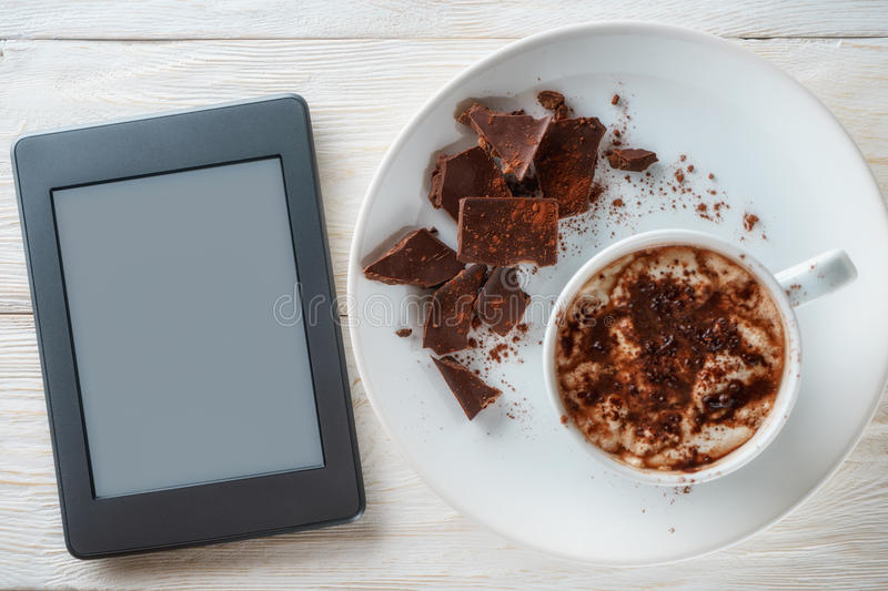 Cocoa and chocolate top view. Mug of cocoa and chocolate on a plate royalty free stock images
