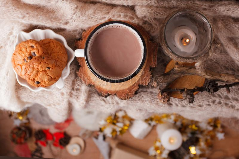 Cocoa with Cozy winter home background, cup of hot cacao with american cookies, warm knitted sweater on vholiday decoration blur royalty free stock photos