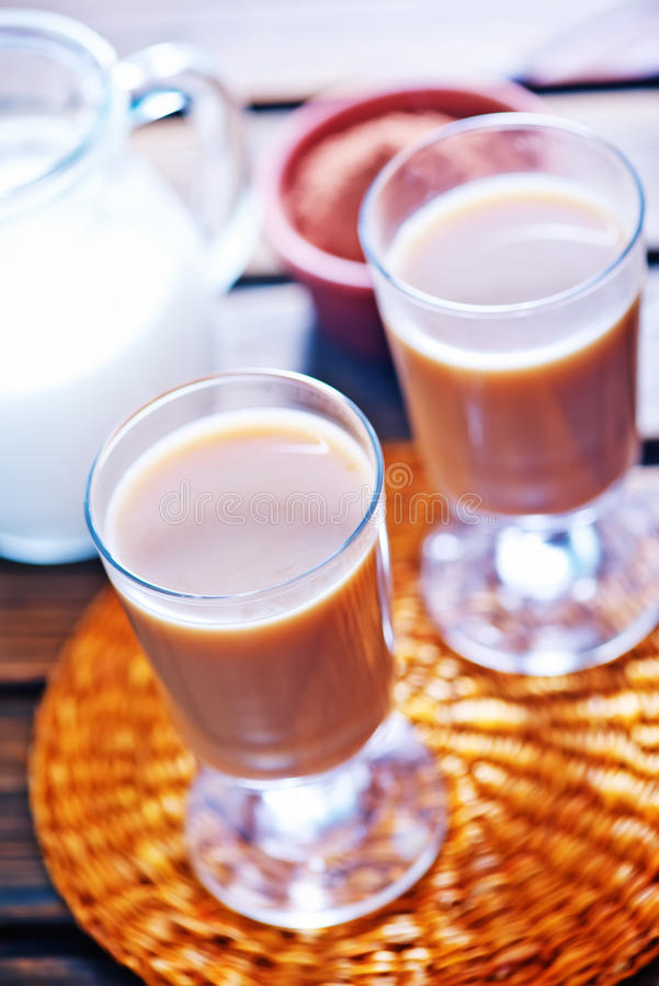 Cocoa drink. In cup and on a table stock photos