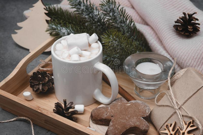 Cocoa, hot chocolate with marshmallows and cinnamon, spruce branch, cookies, gingerbread man, candle stock photos