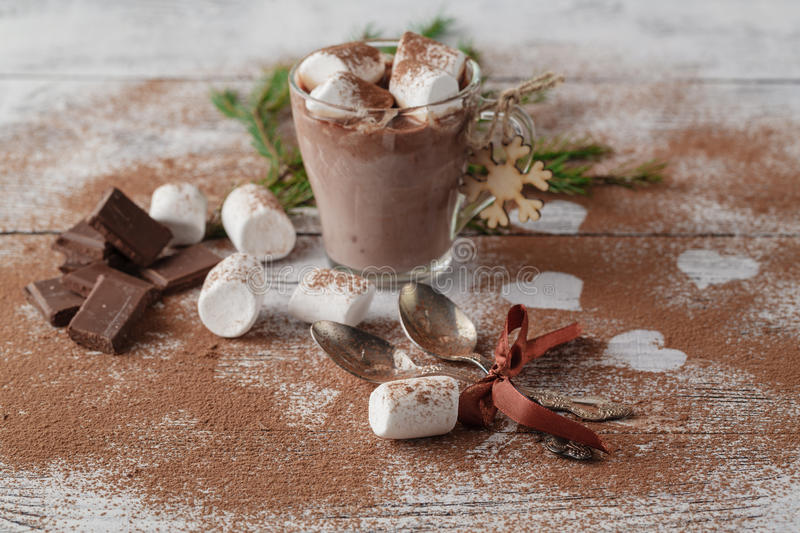 Cocoa or latte or hot chocolate with marshmallow and flavored wi. Th cinnamon. On a wooden background. Christmas present stock images