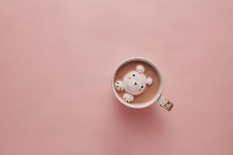Cocoa on pink background with cute marshmallows royalty free stock photos