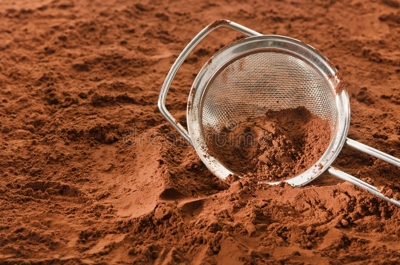 Cocoa powder with sieve. And copy space stock photo