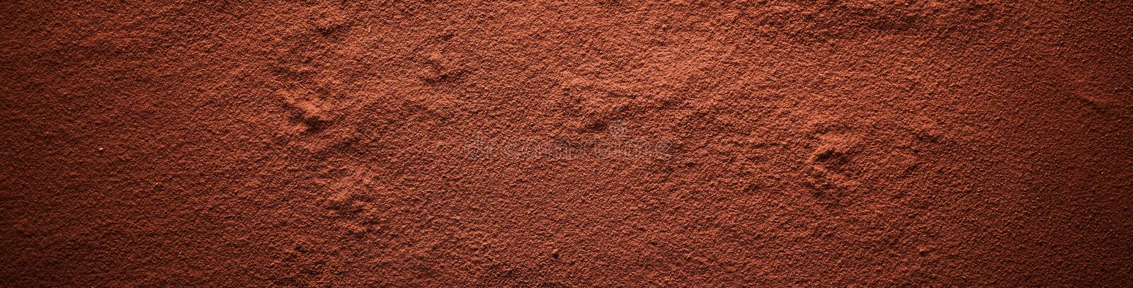 Cocoa powder surface banner. Viewed in full frame from above with darkened vignette effect royalty free stock photos