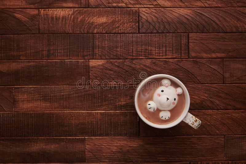 Cocoa on a wooden table with cute marshmallows royalty free stock photos