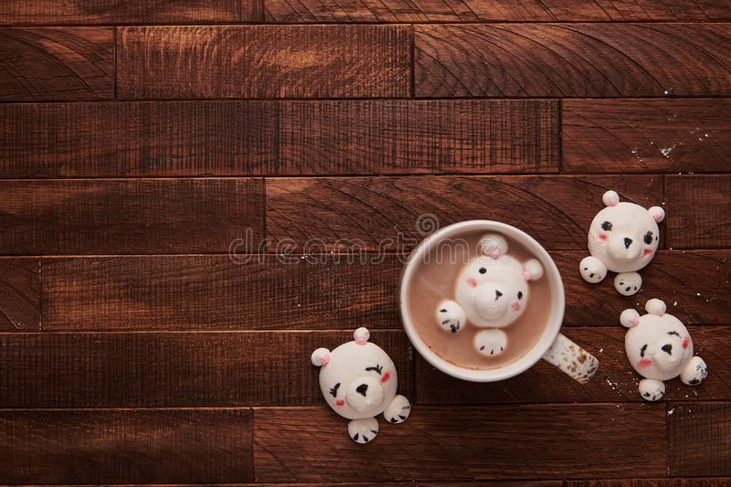 Cocoa on a wooden table with cute marshmallows stock photography