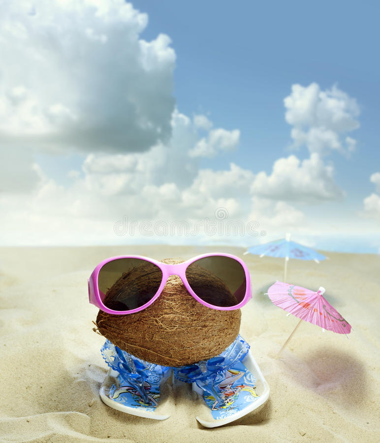 Coconut at beach fun concept royalty free stock photo