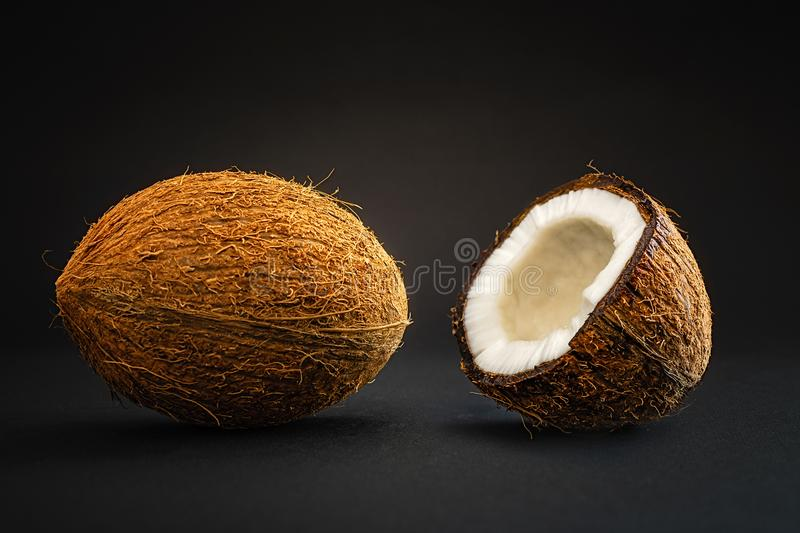 Coconut on a black background stock photography