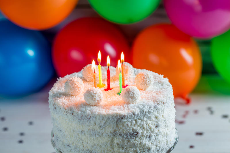 Coconut cake for birthday. On old wooden table stock photos