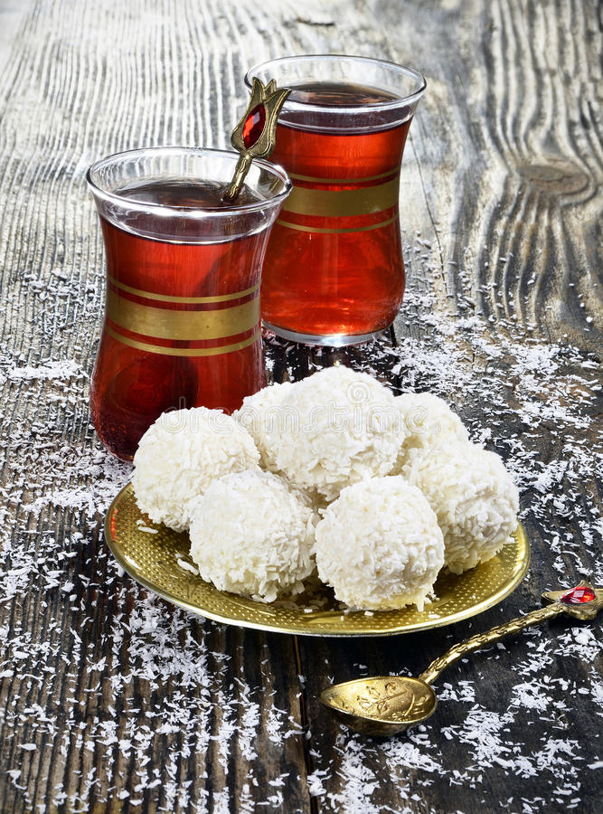 Coconut candy and tea royalty free stock photography