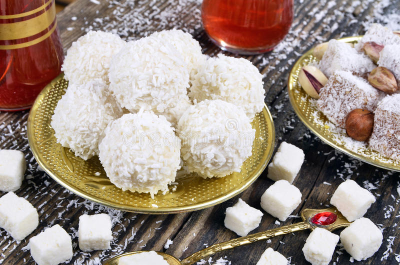 Coconut candy and turkish delight. With coconut on wooden table stock photography