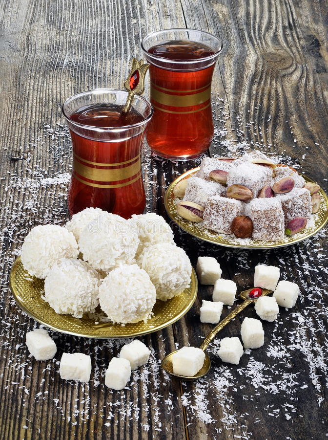 Coconut candy and turkish delight. With coconut on wooden table stock images