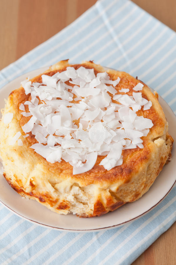 Coconut Cheesecake. Home made Coconut Cheesecake on a white plate stock photos