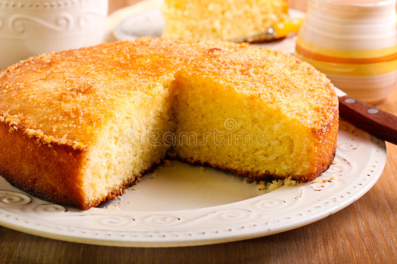 Coconut citrus syrup cake royalty free stock photo