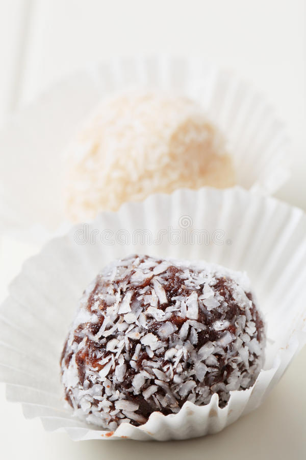 Coconut-coated chocolate balls royalty free stock images