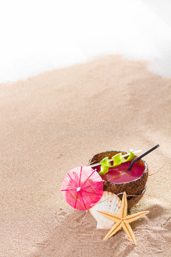 Coconut cocktail on the beach stock image