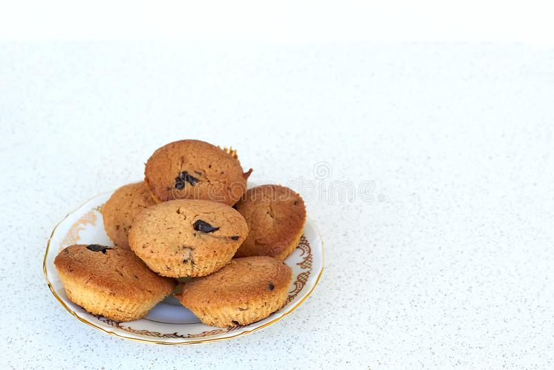 coconut cookies with chocolate chips on a plate left mock up