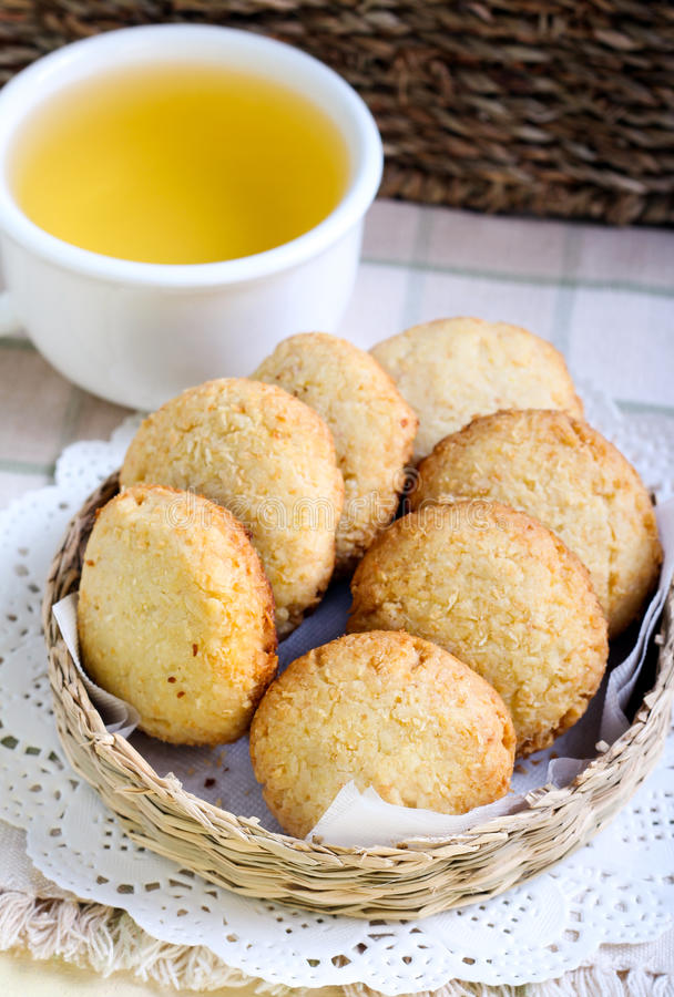 Coconut and cornmeal biscuits. And green tea stock photos