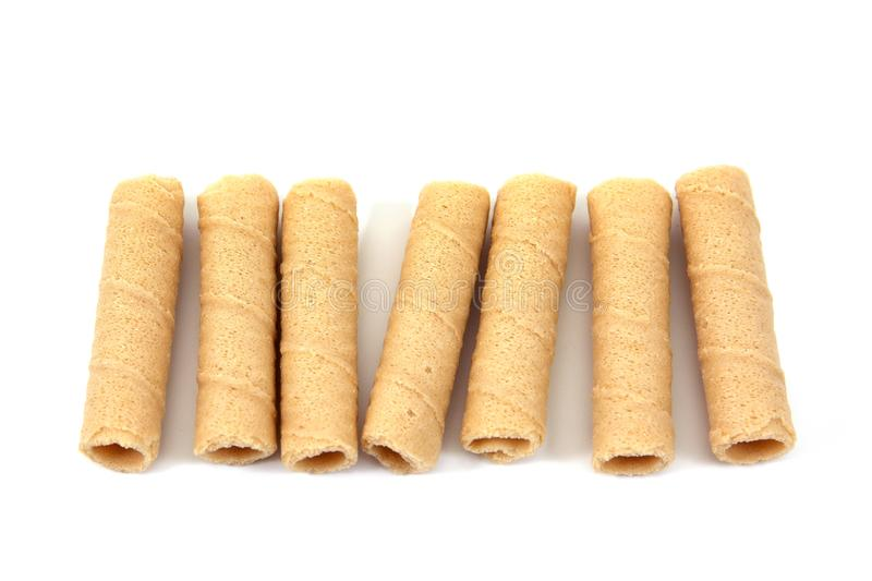 Coconut crispy roll isolated on white background. Tong Muan Thai dessert. Bread sticks isolated. Coconut crispy roll isolated on white background. Tong Muan Thai royalty free stock images