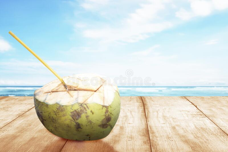 Coconut fruit on the table stock image