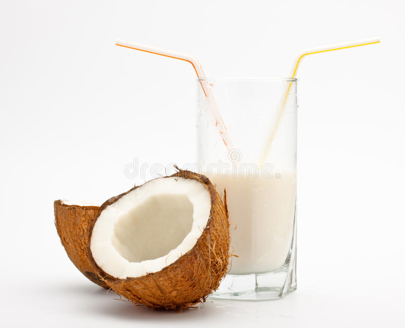 Coconut and glass with coco milk stock photos
