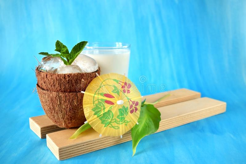 Ingredients for a tropical cocktail on blue background royalty free stock photo