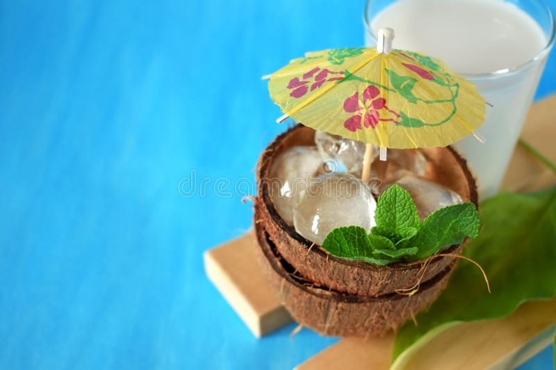 Ingredients for a tropical cocktail on blue background stock photography