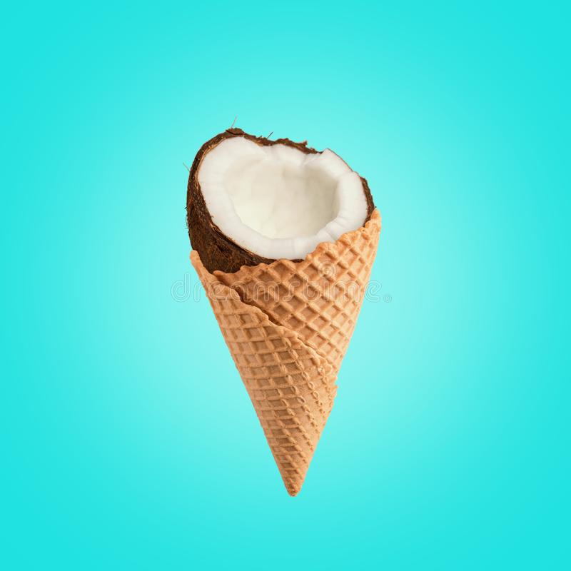 Coconut with ice cream cone on bright background. Food minimal concept royalty free stock photo