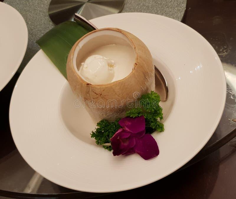 Coconut icecream dessert in husk stock photo