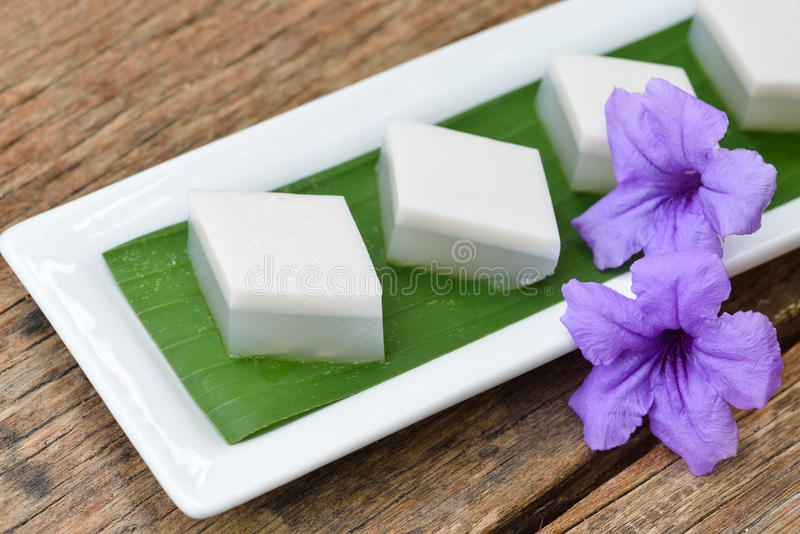 Coconut jelly, thai dessert on old wood background. royalty free stock photos
