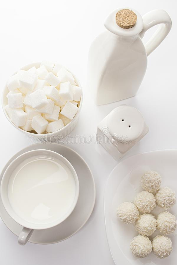 Coconut milk candy sugar pieces, white food on white, top view still life. white dishes and food on a white background, high key stock photography