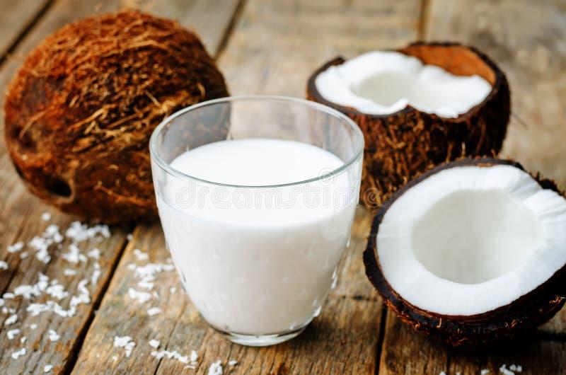 Coconut milk and coconuts stock photos