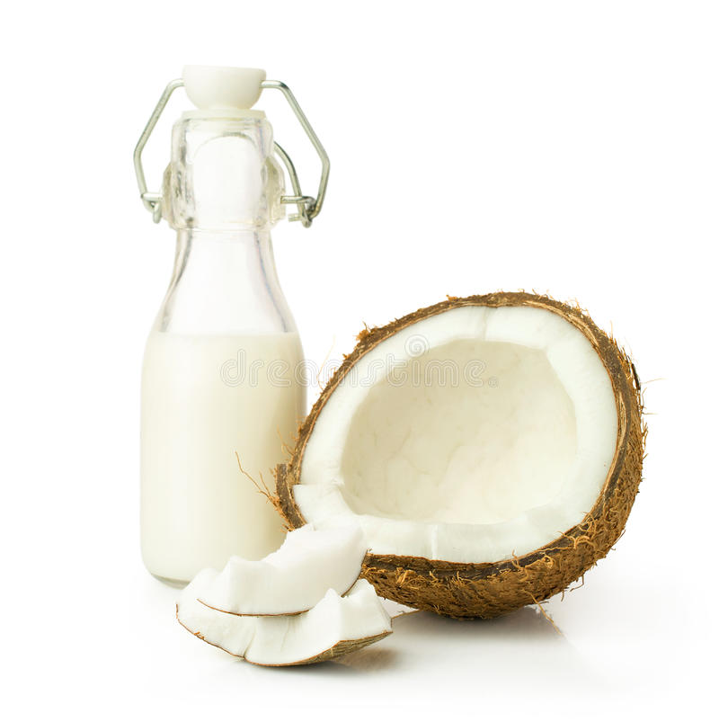 Coconut and milk in a glass bottle stock photo