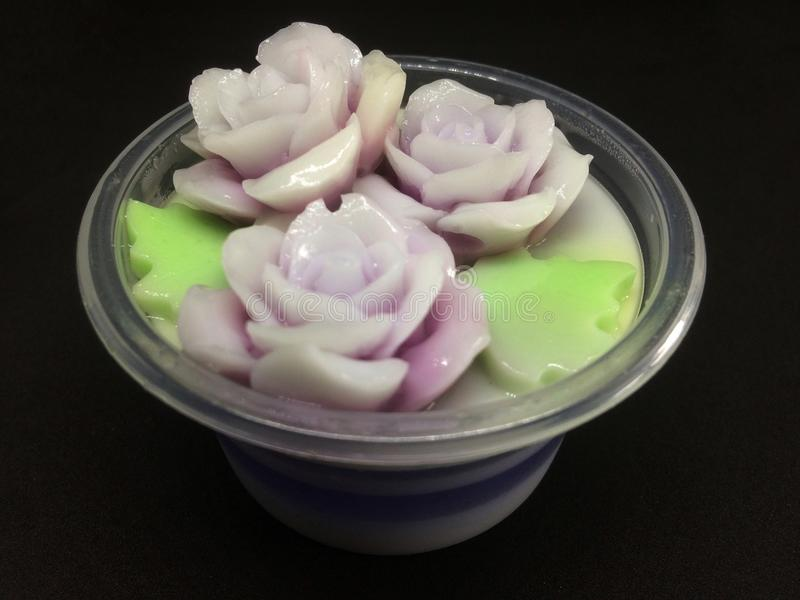 Coconut milk jelly flower in plastic cup. stock photography