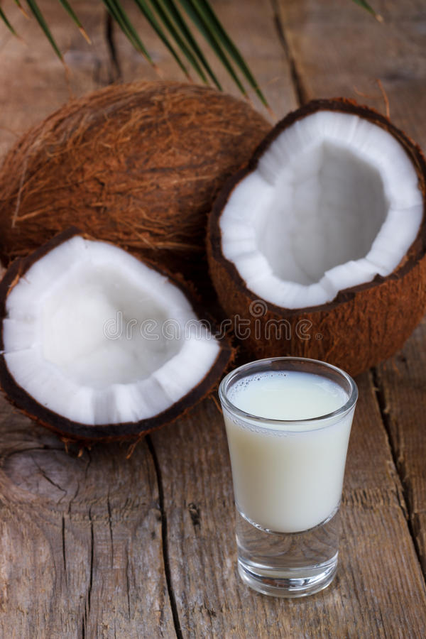Coconut milk and shells royalty free stock photos