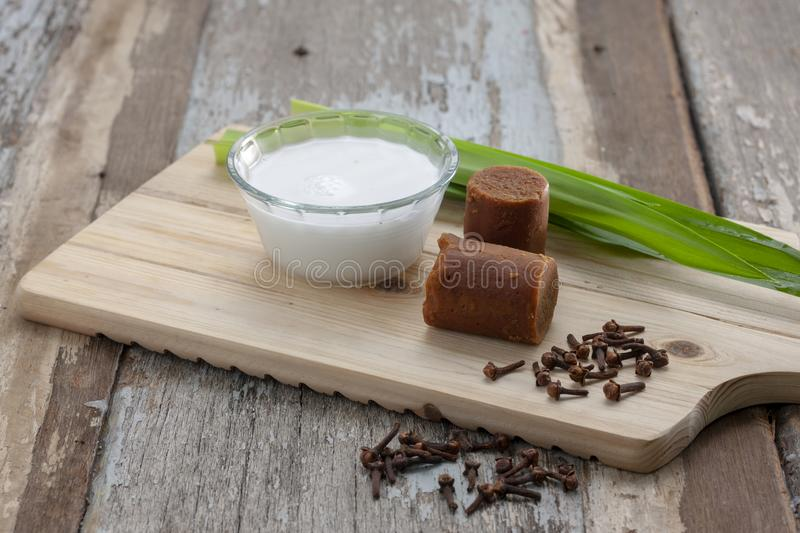 Coconut milk with traditional brown sugar stock photography