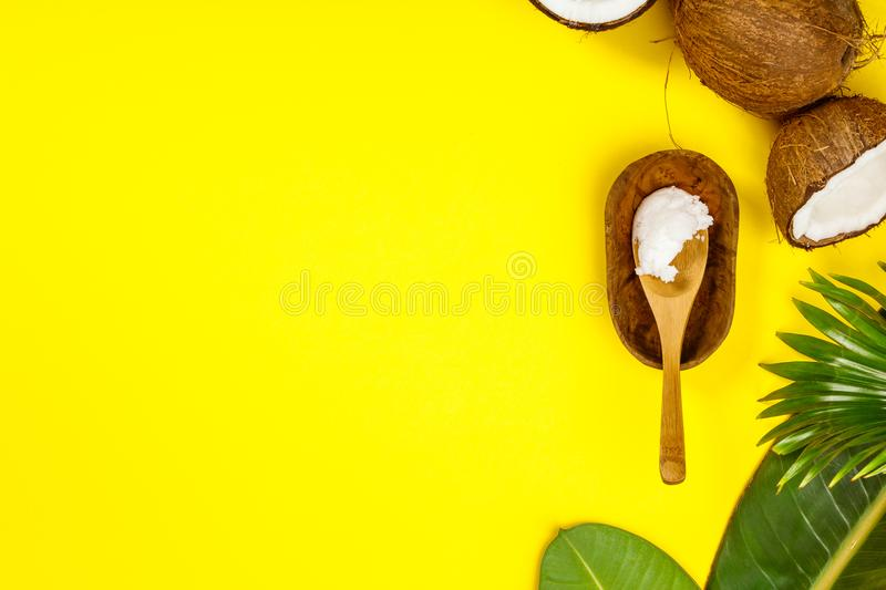 Coconut oil, tropical leaves and fresh coconuts royalty free stock images