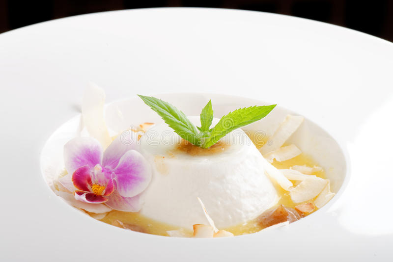 Coconut panna cotta with sour mango. And date puree royalty free stock photo