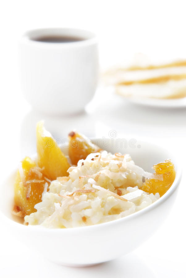 Coconut rice. Bowl of coconut rice with grilled mango and fried won-ton stock photography