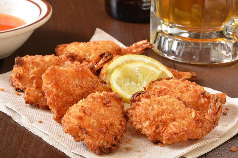 Coconut shrimp and beer royalty free stock image