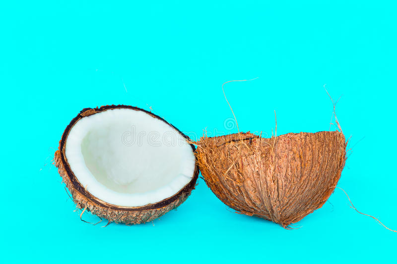 Coconut is split into two parts. royalty free stock photography